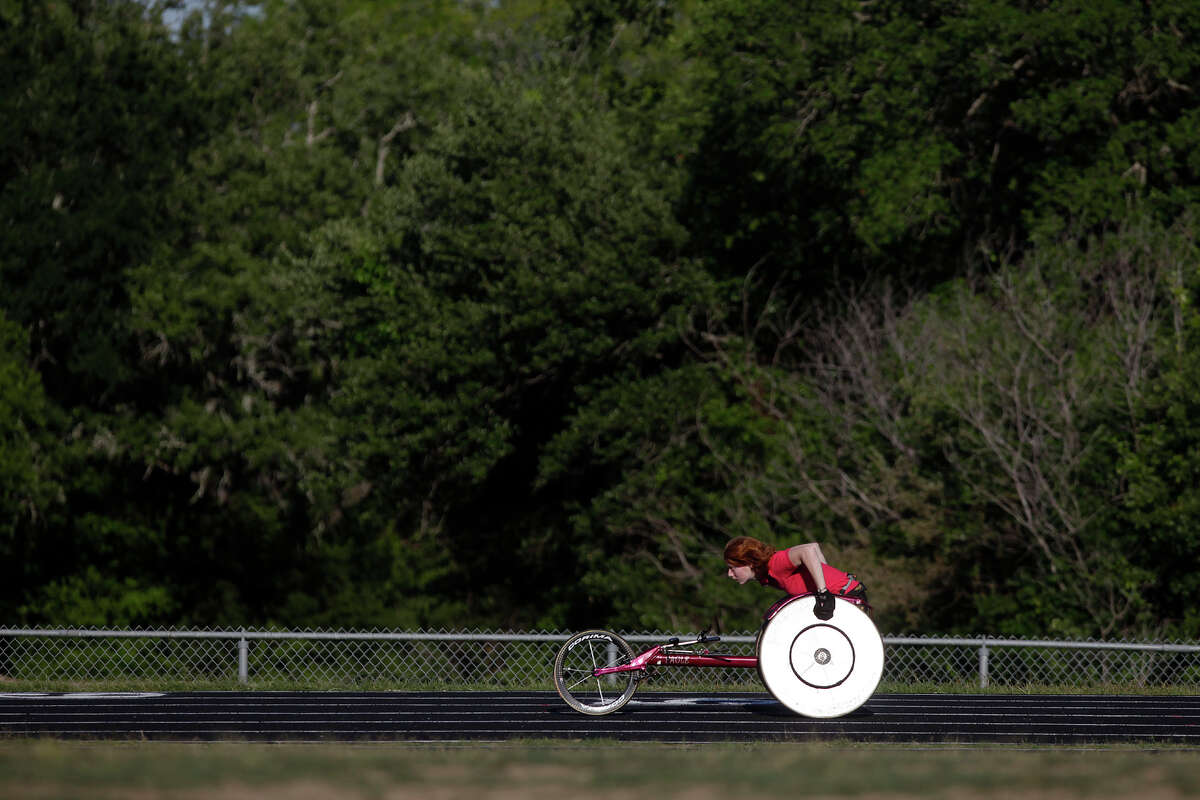 Kristen Messer, 25, of Spokane Valley, WA, works out on the track at Deerpark Middle School, where she attended, in Austin on April 18, 2012. Messer's family lives in Austin and she combined visiting them with competing in this weekend's Texas Regional Games in San Antonio.