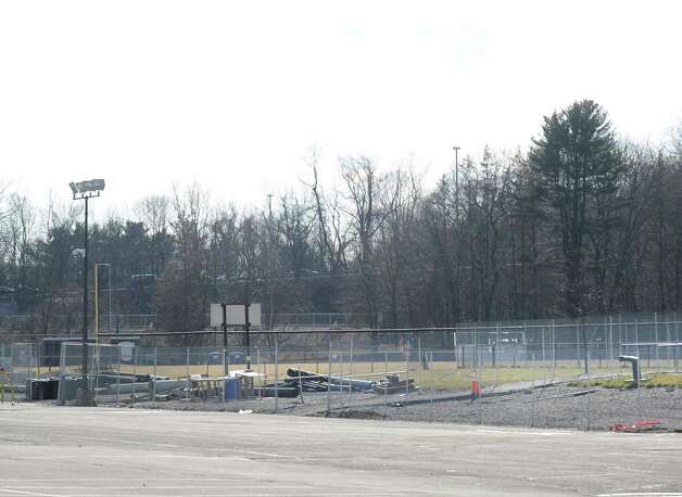 A view of the parking lot and western athletic fields at Greenwich High School. In the latest findings released Friday, April 20, 2012, toxic substances have been found in groundwater in a well located between one of the fields at the center of the property and the back parking lot. This is a spot where the highest PCB levels were also found in the soil. Samples came from 10 wells installed at the school in December and February. Photo: Bob Luckey / Greenwich Time