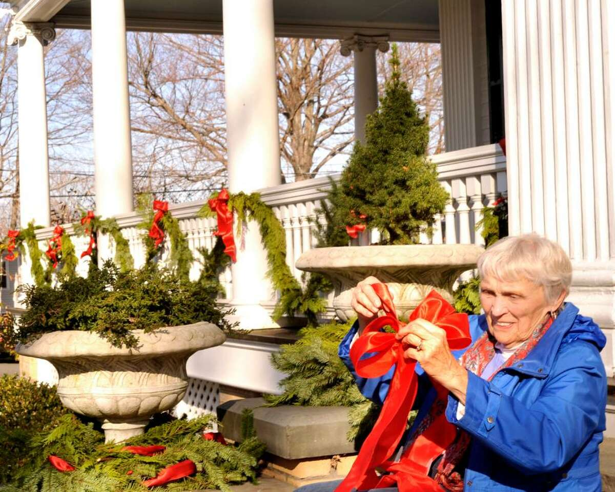 Helen Stevens, 80, 0f Ridgefield, decorates the Ridgefield Community Center, during the Holiday Festival of Trees, on Wendesday,Nov.18,2009.