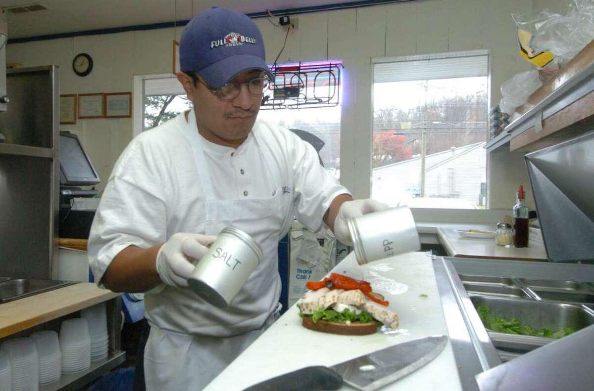 Paulo Vele, of Full Belly Deli in Danbury, makes a sandwhich Friday, Nov. 13, 2009.