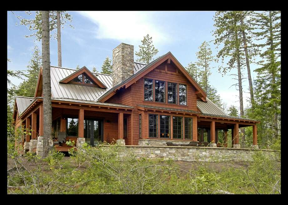 Even if you're not in the market a $1.25 million green home on a resort golf course, it's always fun to check out the pictures. So here's 741 Maple Leaf Loop, in Suncadia resort. The 3,823-square-foot home has four bedrooms, four bathrooms, wood ceilings with exposed beams, a two-story living room with a huge stone fireplace, a wine cellar, media room/office, reading loft, a two-car garage, patios and decks on a 0.41-acre lot at the 13th hole of Prospector Golf Course. And it has top-level 5-star certification under the Built Green green building program. Photo: Courtesy Eric Slawson/Keller Williams