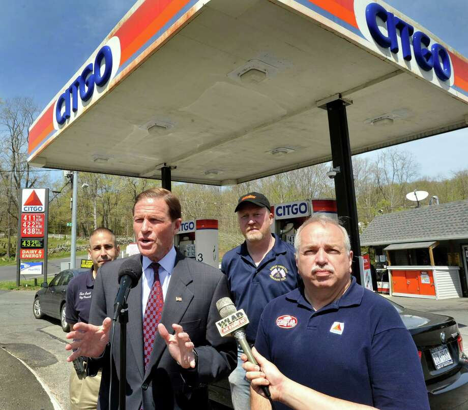 U.S. Sen. Richard Blumenthal, D-Conn., center, speaks during a press conference outside the Danbury gas station of Barry Connell, right, Friday, April 20, 2012. Included from left are Tom Saadi, City Council member, Blumenthal, Ken Gucker, Democratic Town Committee vice chairman, and Connell. Photo: Michael Duffy