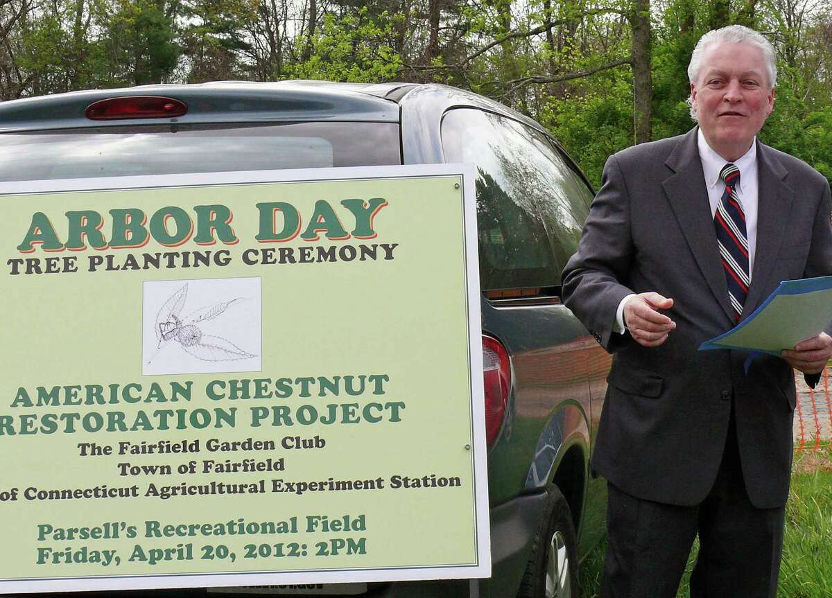 First Selectman Mike Tetreau reads a proclamation marking the town's 25th Arbor Day celebration Friday at the softball field on Hoydens Lane. Twenty-five American Chestnut trees were planted at the property, donated by the Fairfield Garden Club.