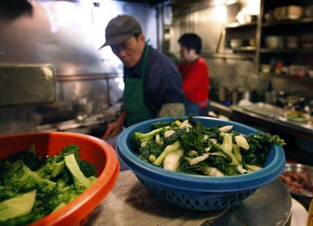 Broccoli and bok choy are ready to stir-fry. (Paul Chinn / The Chronicle)