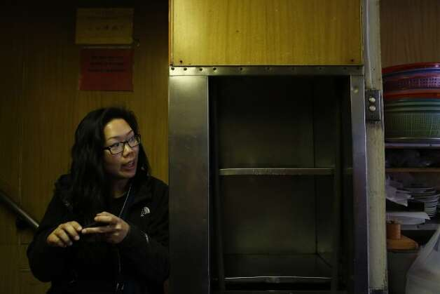 Julie Ho and the dumbwaiter (Mike Kepka / The Chronicle)