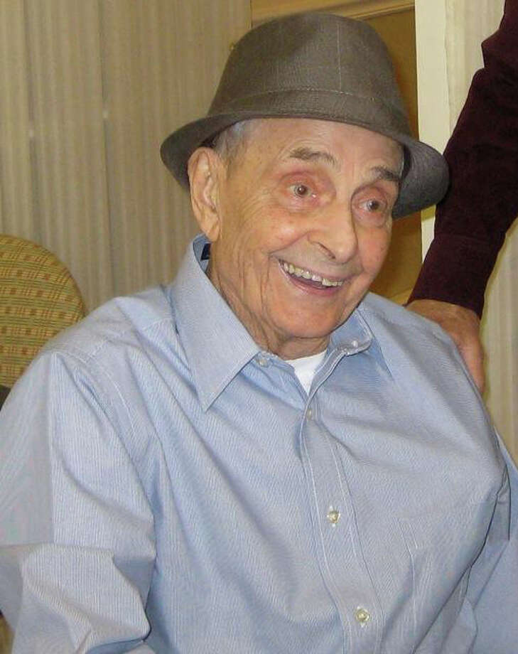 Charles Arnone, a decorated World War II veteran who passed away on Tuesday, April 17, 2012, is shown here at his 95th birthday party in 2011. Photo: Contributed Photo
