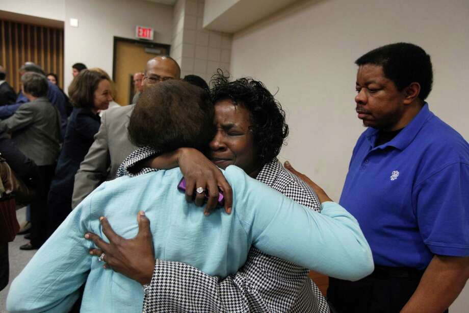 Shirley Burns, center, celebrates with her friend, Margaret Tinsley, after a judge found that racial bias played a role in the trial and death penalty sentence of Burns' son, Marcus Robinson, on Friday in Fayetteville, N.C. It was the first case to be decided under North Carolina's Racial Justice Act. Photo: Shawn Rocco / Raleigh News & Observer