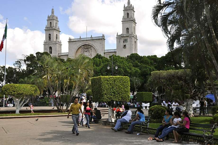 Merida's leafy Plaza Mayor, one of the prettiest in Mexico, should be a visitor's first stop. Photo: Christine DelSol, Special To The Chronicle