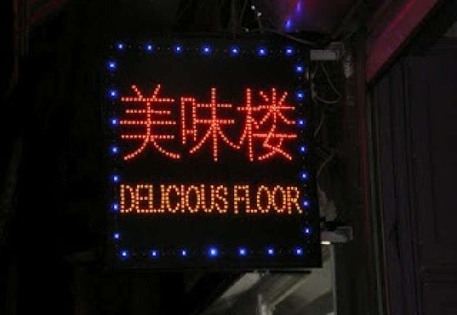 Feel free to eat food that falls on the floor - or the floor itself - at this Brussels restaurant. Photo: Stephanie Booth/Signspotting.com