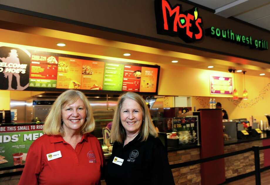 Owners Mary and Jeannine McMillan stand in front of MoeâÄôs Southwest Grill at the new Travel Plaza off I-95 between exits 41 and 40 Southbound in Milford.  The sisters opened their first MoeâÄôs in New Haven and have had so much success that they decided to open another in Milford. Photo: Autumn Driscoll / Connecticut Post
