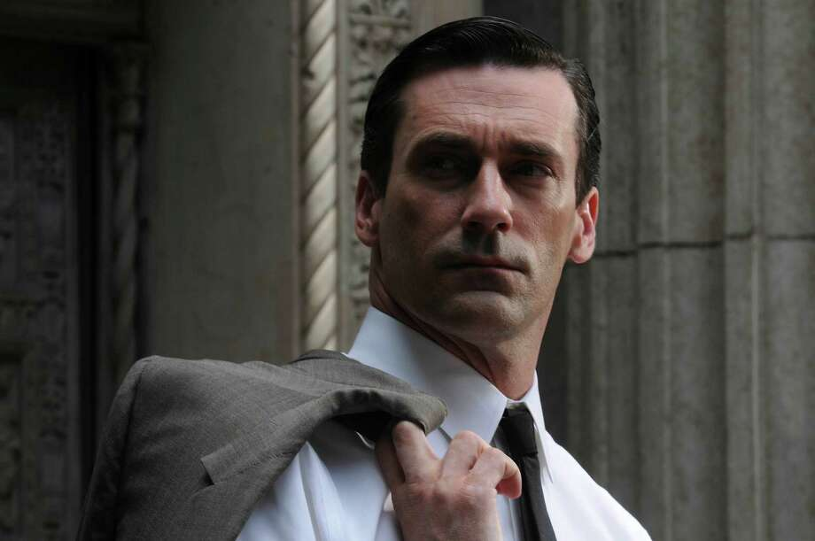 """Don Draper (Jon Hamm) of """"Mad Men"""" could keep his hair sleek by using coconut oil, which contains vitamin E and saturated fats, great for skin and hair. Photo: AMC / Copyright: AMC 2010"""