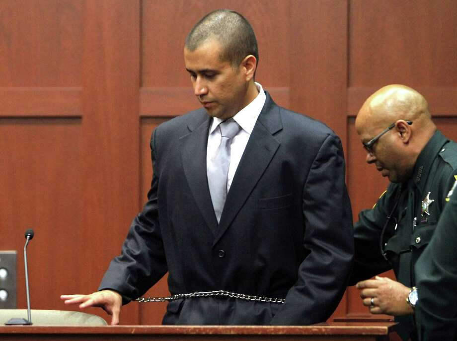 "George Zimmerman testified that he didn't know if  17-yearold Trayvon Martin ""was armed or not"" before their Feb. 26 confrontation in Sanford, Fla. Photo: Gary W. Green / POOL Orlando Sentinel"
