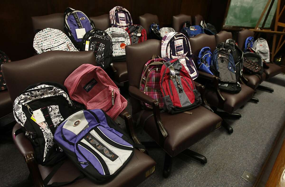 Chairs normally occupied by jurors are filled with backpacks that were awarded to students who graduated from a truancy prevention program at the Alameda County Courthouse in Oakland, Calif. on Friday, June 17, 2011. More than two dozen parents prosecuted for their children's truancy had their cases dismissed after the family completed a program and the students raised their school attendance records.