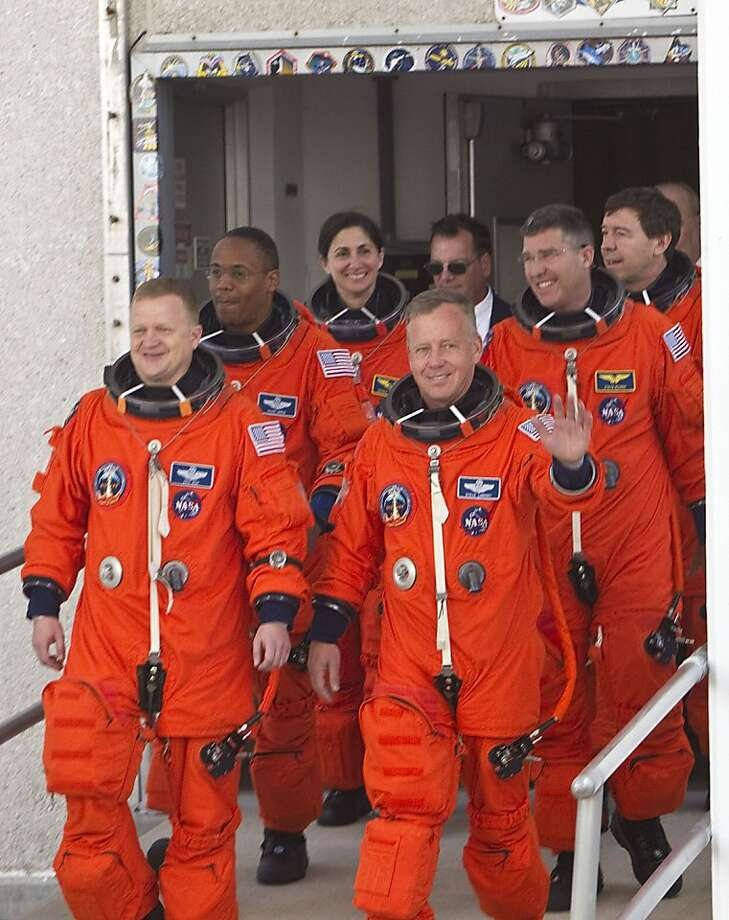 Space shuttle Discovery's  STS-133 astronauts pilot Eric Boe left front, Alvin Drew left middle, Nicloe Stott left rear, commander Steven Lindsey right front, Steven Bowen right middle and Michael Barratt right rear during the crew walkout for the space shuttle Discovery's final mission at NASA Kennedy Space Center Thursday, Feb. 24, 2011, in Kennedy Space Center .  ( James Nielsen / Houston Chronicle ) Photo: James Nielsen, Houston Chronicle