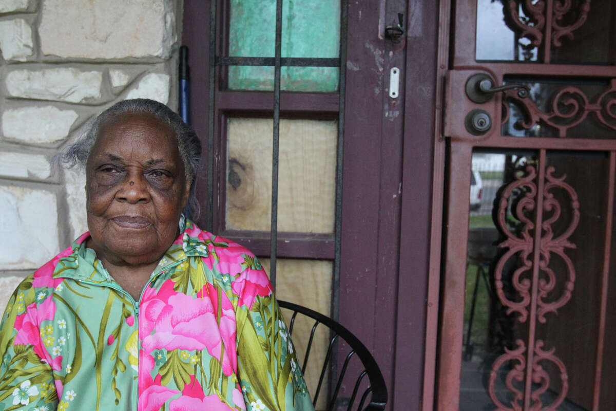 Fannie Mae Brown, 89, sits on her front porch at her East Side home where people recently attempted a home invasion. Early last Thursday morning Brown fired a shot at the criminals, scaring them enough to send the scrambling from her home. Brown is sitting by the door where the break-in took place.