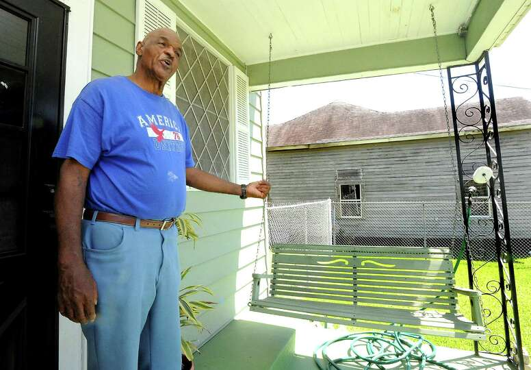Vernon Azore talks about the home next door that burned on Sabine Pass Avenue in Beaumont, Wednesday
