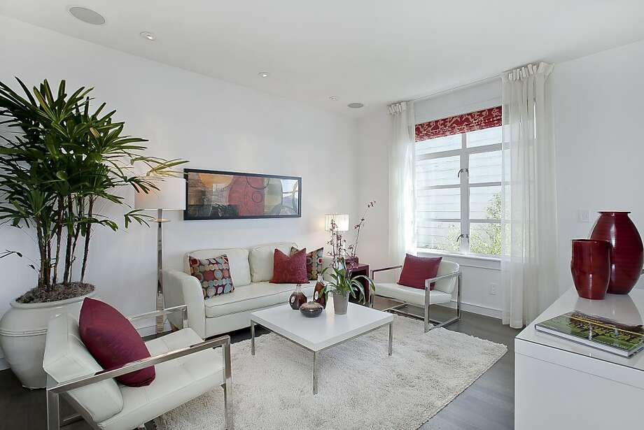 Designer Steven Gray said the same canvas-white paint from the exterior was used inside as well to emphasize the space and light of the home. Photo: Open Homes Photography