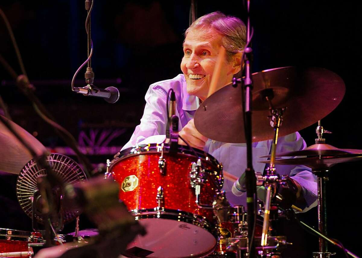 In this Nov. 18, 2011 photo, Levon Helm plays drums during the
