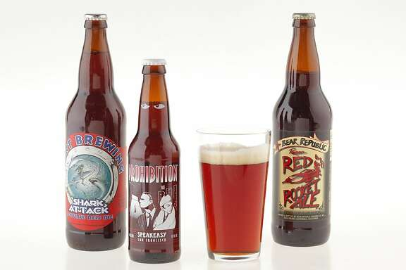 From left, Port Brewing Shark Attack Double Red Ale, Bear Republic Red Rocket Ale, and Speakeasy Prohibition Ale.