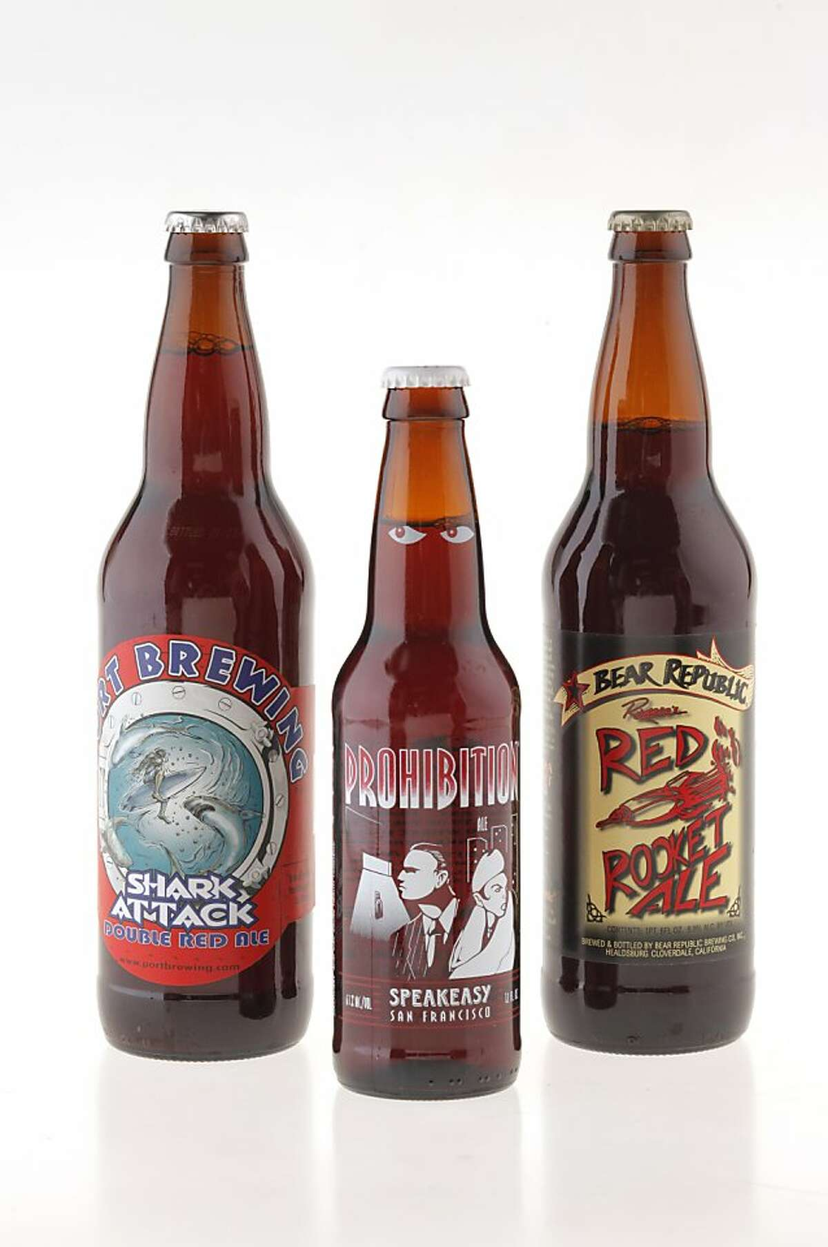 From left: Port Brewing Shark Attack Double Red Ale, Speakeasy Prohibition Ale, and Bear Republic Red Rocket Ale.