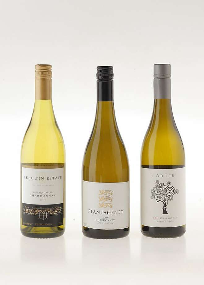 Australian Chardonnays, from left: 2009 Leeuwin Prelude Vineyards Margaret River Chardonnay; 2009 Plantagenet Mt. Barker Chardonnay; 2010 Ad Lib Tree Hugger Margaret River Chardonnay Photo: Craig Lee, Special To The Chronicle