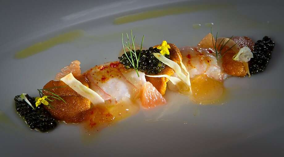 Scottish langoustine crudo has slices of langoustine arranged to mimic the shape of the tail. Photo: John Storey