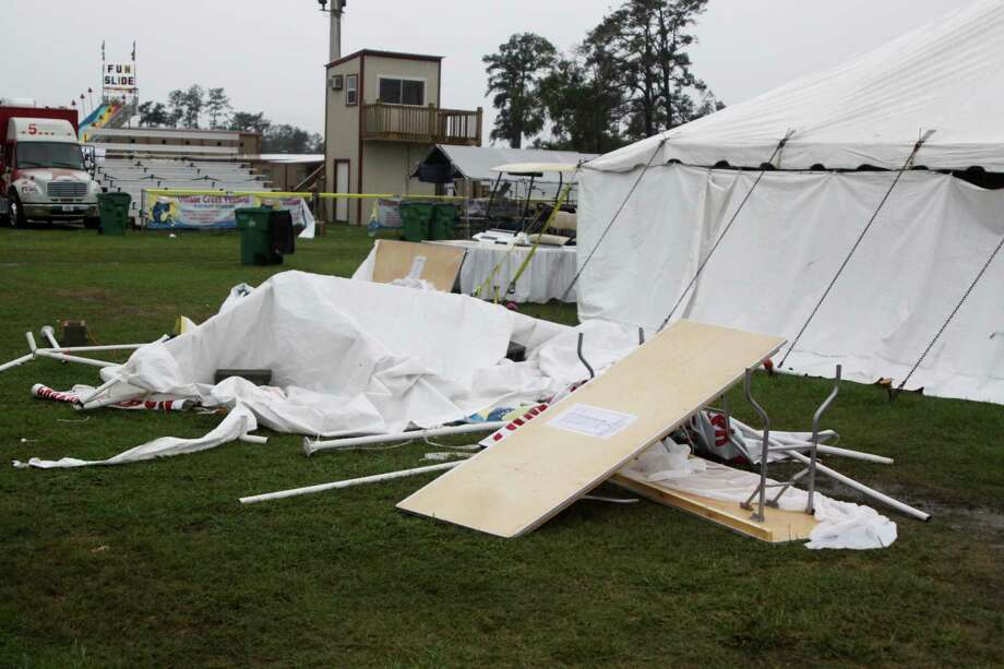 Rain and damaging winds roared through Hardin County Friday evening, overturning tents, trash cans, flower pots, and rails at the Village Creek Festival. Although the winds left a big mess at the grounds, organizers plan to work through the night to be ready for festivities to begin as scheduled Saturday morning. Photo: David Lisenby, HCN_Winds