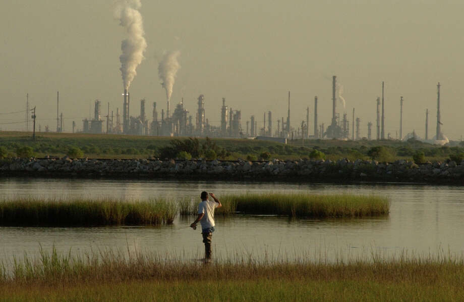 Texas City: After the latest BP explosion any kind of noise coming from Texas City makes people nervous. A fisherman hears something and looks over at chemical plants in Texas City.  BP in background. Photo by Carlos Antonio Rios, Houston Chronicle Photo: Carlos Antonio Rios / Houston Chronicle