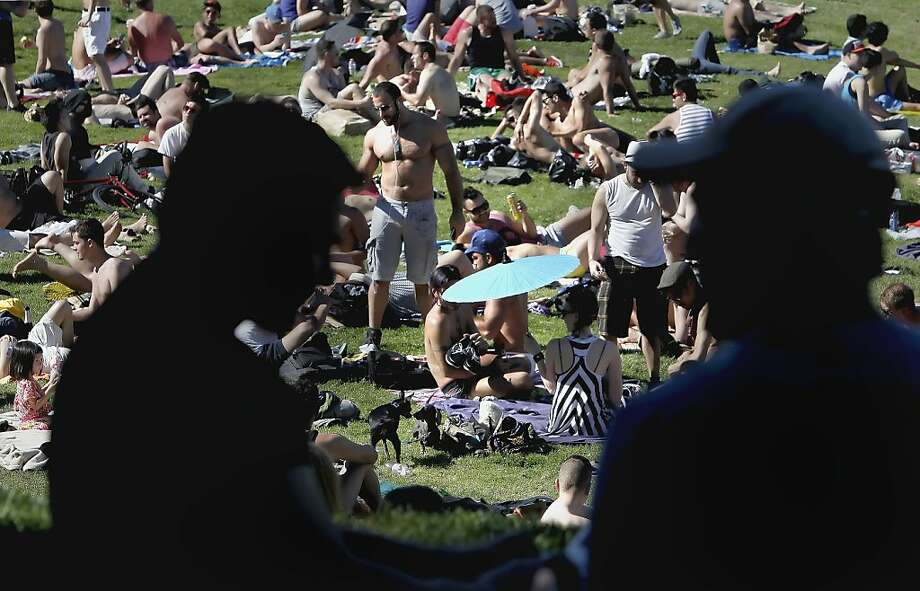 A day for parsols and shirts off as people flocked to Dolores Park in the Mission District to enjoy the warm weather, in San Francisco, Ca., on Friday April 20, 2012. Photo: Michael Macor, The Chronicle