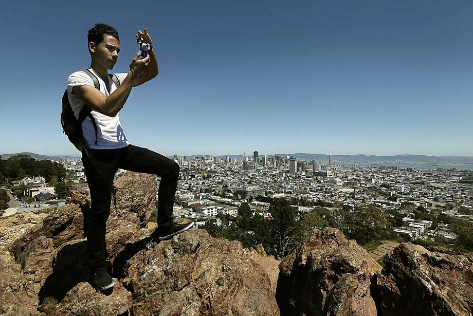 Leo Paulino, visiting from New York City takes in the view of San Fracisco, Ca., during his first time here, looking from Corona Heights, on Friday April 20, 2012. He commented on what a beautiful city San Francisco is, saying he liked the hills. Photo: Michael Macor, The Chronicle