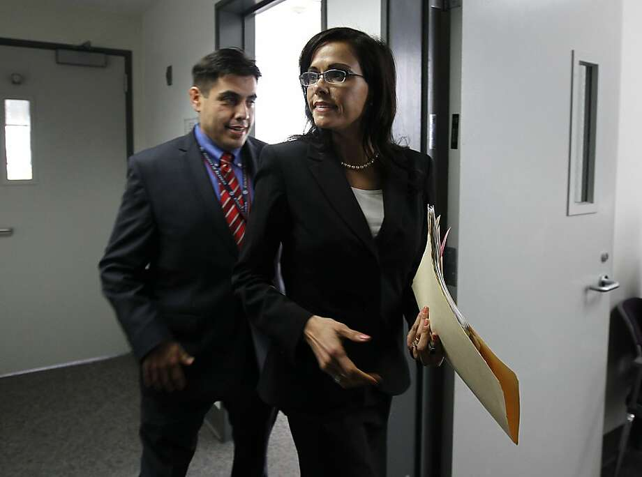 Alameda County Supervisor Nadia Lockyer walks to a conference room with her chief of staff Ruben Briones to attend a special meeting of the board of supervisors in Oakland, Calif. on Tuesday, March 20, 2012. It was Lockyer's first meeting since she entered a substance abuse treatment program following an incident with an ex-boyfriend. Photo: Paul Chinn, The Chronicle