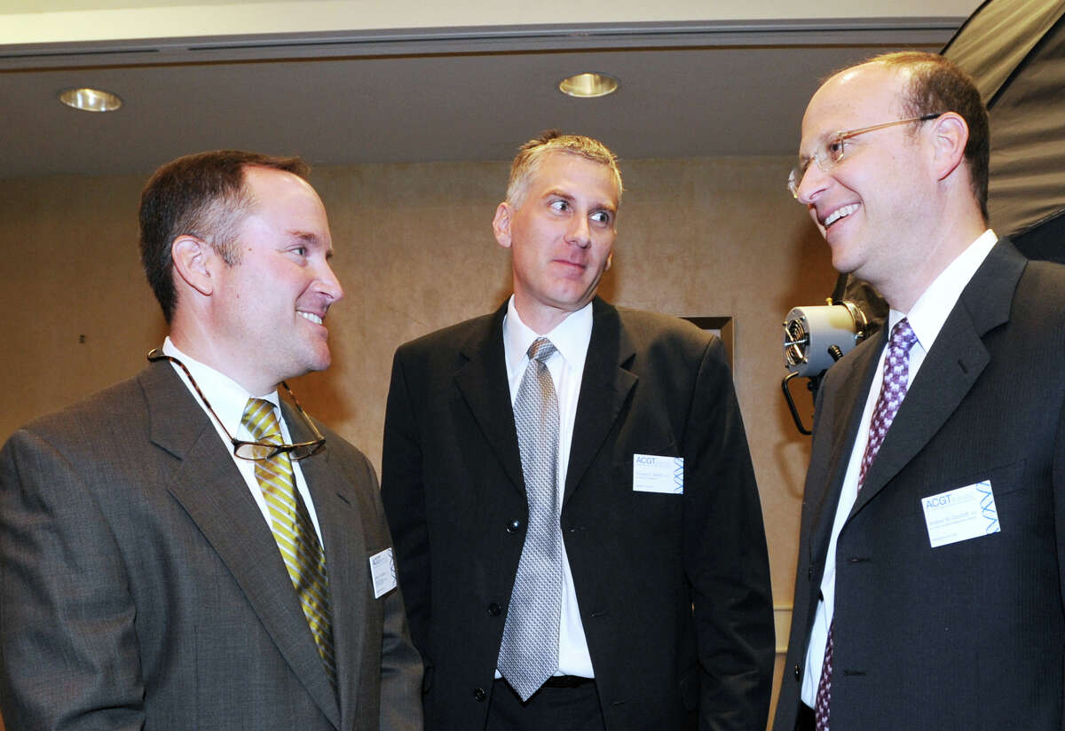 Scientists, from left, Jeffrey Bartlett of Ohio State University and Thomas Griffith of the University of Minnesota, speak with Dr. Andrew Davidoff, right, of St. Jude Children's Research Hospital in Memphis, Tenn., during the Alliance for Cancer Gene Therapy's 10th anniversary celebration at Hyatt Regency Greenwich, Thursday, April 19, 2012.
