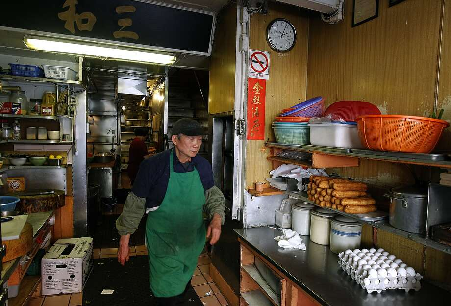 Cook Sen Ren Situ walks through the tiny kitchen of Chinatown's legendary Sam Wo restaurant in San Francisco, Calif. on Thursday, April 19, 2012. The restaurant's owner is closing its doors for good on Friday. Photo: Paul Chinn, The Chronicle