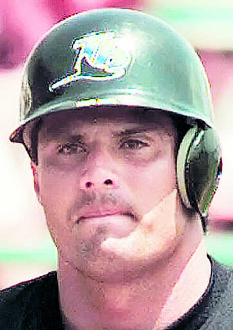 """**FILE**In this April 3, 1999 file photo, Tampa Bay Devil Rays' Jose Canseco reacts after striking out during a spring training game against the Pittsburgh Pirates at Al Lang Stadium in Clearwater, Fla. Call it the Sad Sack Series in 2008, from Philadelphia, the losingest team in pro sports history to Tampa Bay, a club that on opening day could have made a strong case for worst expansion franchise ever. Tampa Bay tried to rely on other team's fading stars to build a fan base, like Canseco, Fred McGriff and Vinny Castilla were """"Past-Their-Prime-Time Players"""" and all busts with Tampa Bay.  (AP Photo/Chris Gardner, File) Photo: CHRIS GARDNER / AP"""
