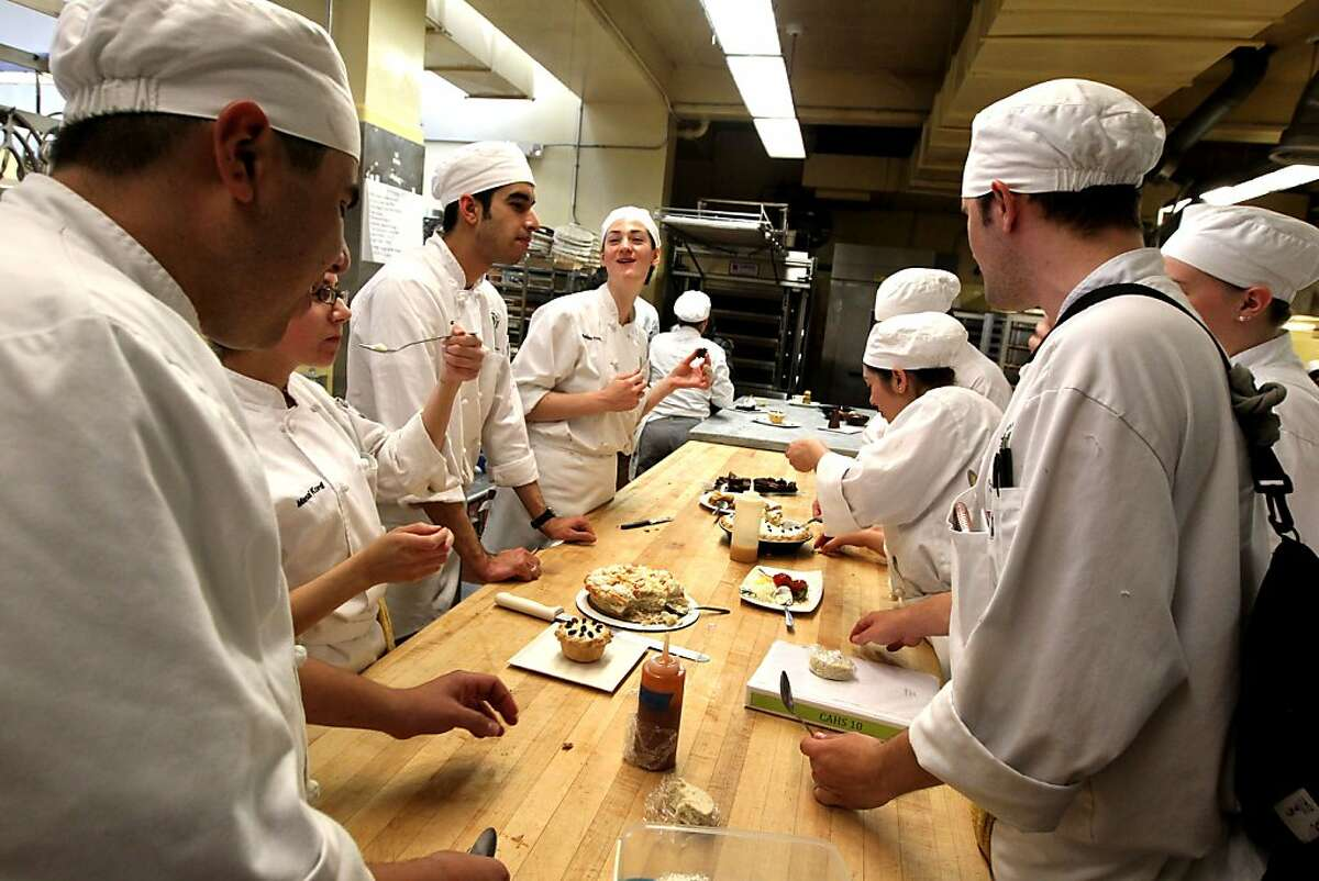 Student cooks sample pastries in the cafeteria kitchen at City College of San Francisco on Tuesday April 17, 2012 in San Francisco, Calif. San Francisco City College has one of the best culinary arts and hospitality management programs in the state. Eighty percent of its graduates are offered employment in Northern California restaurants, hotels and food service companies. Not only is the program comprehensive, but also it's relatively cheap?'when compared to private schools. But with State budget looming, cuts to the program are feared. Desk:Ê