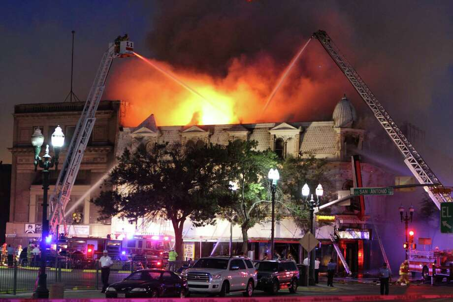 A three-alarm fire raged for more than four hours on Thursday night, gutting one of the oldest buildings in downtown El Paso.  Flames shot out from the top of the structure, as little by little parts of the building were consumed, while more than 110 firefighters poured streams of water from the ground and aerial ladders.  The building at 100 E. San Antonio had been a landmark in the heart of El Paso since the 1880s. It had once been the First National Bank and the law offices of famed gunfighter John Wesley Hardin.   Photo by Ruben R Ramirez/El Paso Times Photo: Ruben R Ramirez