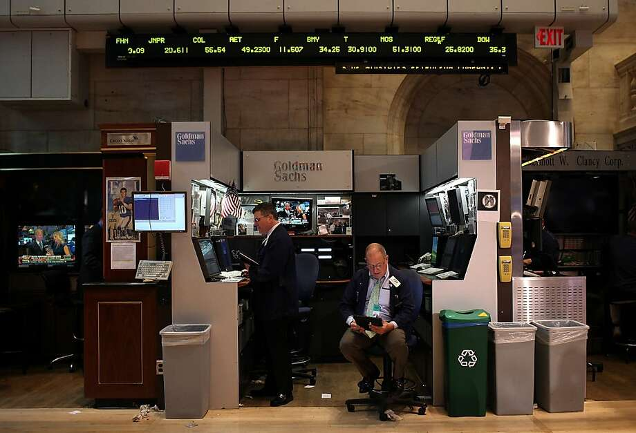 NEW YORK, NY - APRIL 20:  Traders work on the trading floor at the New York Stock Exchange on April 20, 2012 in New York City. The Dow jones Industrial Average was up 65 points to 13029 as Wall Street saw its first positive week in a month that was fueled by strong corporate earnings.  (Photo by Justin Sullivan/Getty Images) Photo: Justin Sullivan, Getty Images