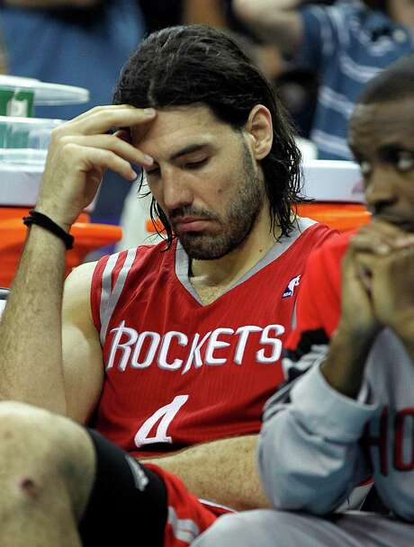 As the Rockets fall behind to New Orleans on Thursday en route to their sixth consecutive loss, forward Luis Scola's disappointment is apparent. Photo: Gerald Herbert / AP