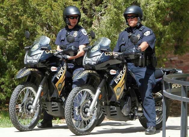 University Police on motorcycles stand watch at the University of Colorado in Boulder, Colo., on Friday, April 20, 2012. The university closed the campus to prohibit an annual 420 marijuana smoke out. (AP Photo/Ed Andrieski) Photo: Ed Andrieski