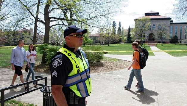 Boulder County Sheriff Sgt. Jeff Goetz stands watch at the Norlin Quad at the University of Colorado in Boulder, Colo., on Friday, April 20, 2012. The university closed the area and the campus to prohibit an annual 420 marijuana smoke out. (AP Photo/Ed Andrieski) Photo: Ed Andrieski