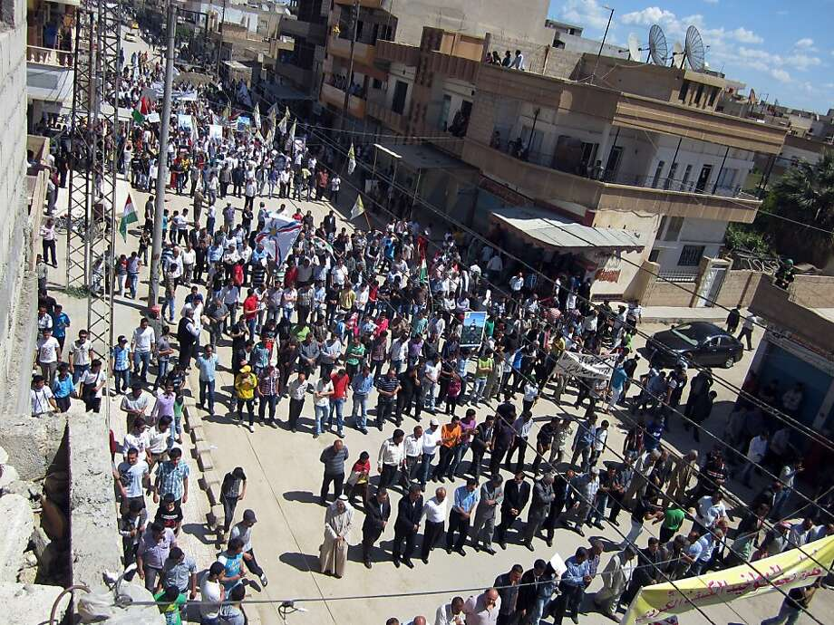 Syrians rally against the regime in the city of Qamishli on April 20, 2012. The internationally-backed ceasefire in Syria is in a fragile state and the situation on the ground is not good, a spokesman for the plan's architect Kofi Annan said on April 20, 2012. Photo: -, AFP/Getty Images