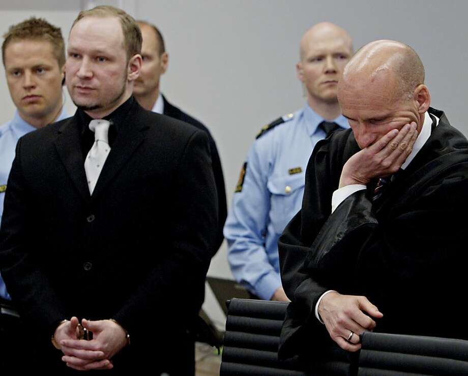 Self-confessed mass murderer and right-wing extremist Anders Behring Breivik (L) and his defence lawyer Geir Lippestad (R) attend a hearing at the courtroom on the fifth-day of his murder trial in Oslo on April 20, 2012. Breivik took the stand on April 20 to describe in detail his shooting massacre on a Norwegian island last year, in what his lawyer warned would be the most difficult testimony to hear. Photo: Stian Lysberg Solum, AFP/Getty Images