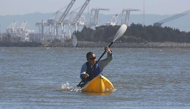 Andy Zaidi from Oakland kayaking toward the Berkeley Marina in Berkeley, Calif.,  on Friday, April 20, 2012. Photo: Liz Hafalia, The Chronicle