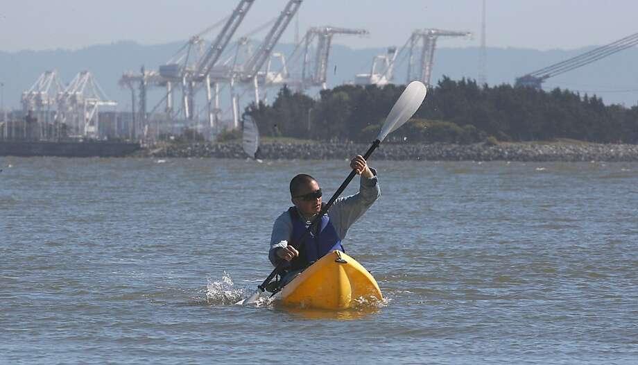 Andy Zaidi from Oakland kayaking toward the Berkeley Marina in Berkeley, Calif.,  on Friday, April 20, 2012. Photo: Liz Hafalia, The Chronicle