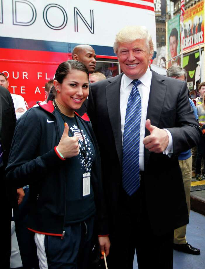 NEW YORK, NY - APRIL 18:  Donald Trump poses for a photo with boxing Olympic hopeful Marlen Esparza of the United States during the Team USA Road to London 100 Days Out Celebration in Times Square on April 18, 2012 in New York City.  (Photo by Jeff Zelevansky/Getty Images for USOC) Photo: Jeff Zelevansky / 2012 Getty Images
