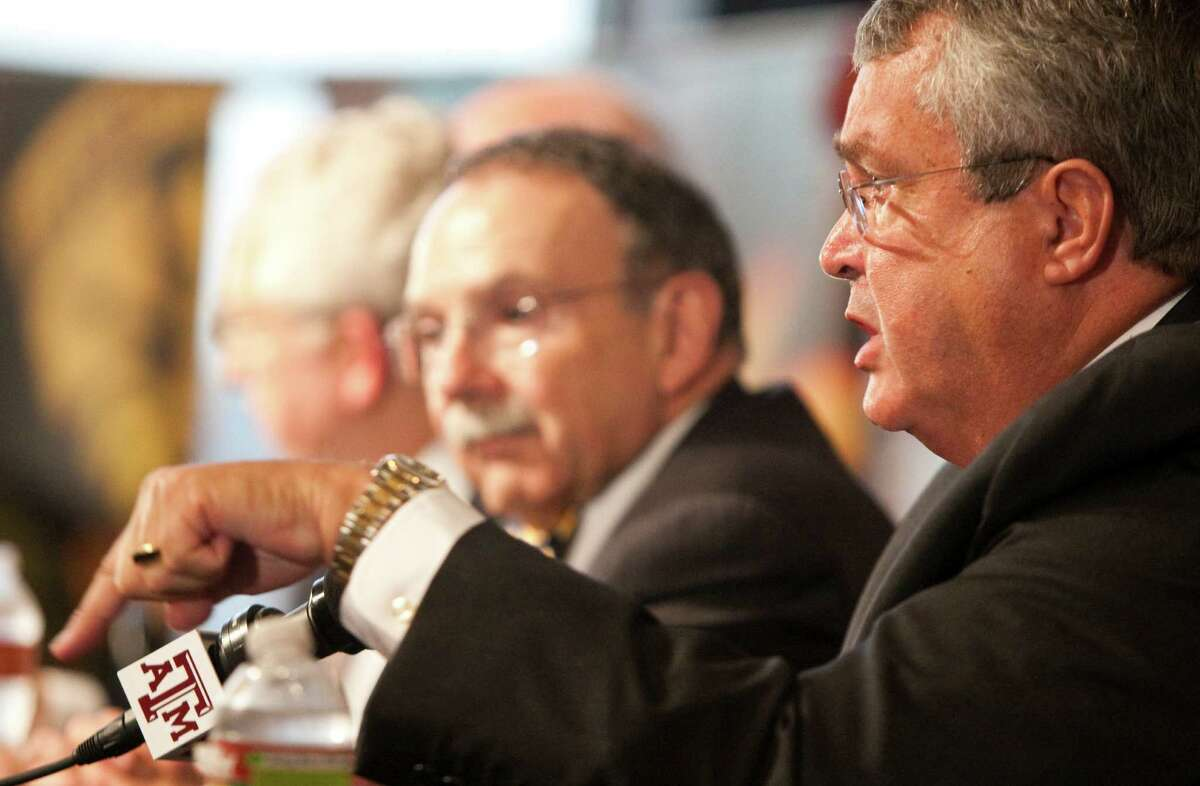 University president R. Bowen Loftin, background, was the driving force behind A&M's move to the SEC, while athletic director Bill Byrne, who had helped get the Big 12 off the ground while at Nebraska, played a smaller role.