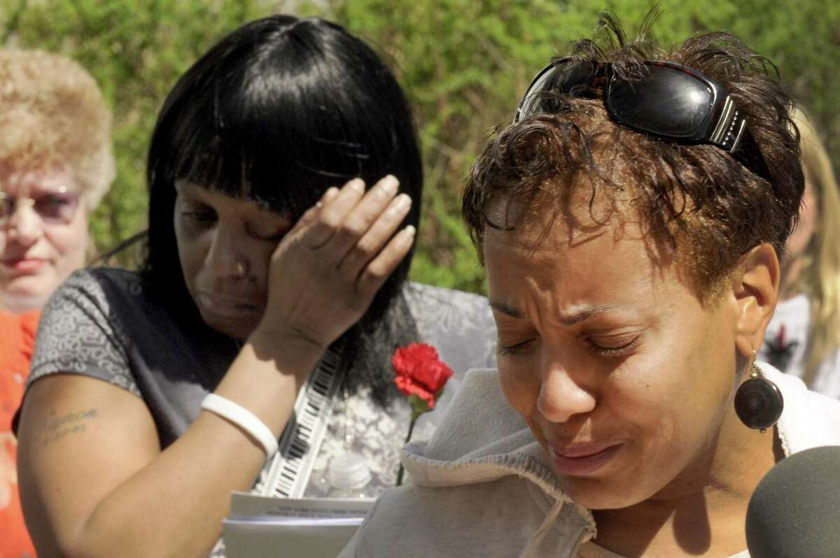 Mothers Ann Ingram, right, and Wanda Turner, left, both of Albany who lost their sons to violent crime speak their lost one's names during the annual Memorial Brick Dedication Ceremony in honor of victims of crime all across New York State in Albany N.Y. Friday April 20, 2012. (Michael P. Farrell/Times Union)