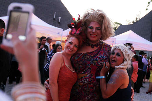 Deseere Cruz, left, and Terri Ann Vasquez pose for a photo with Diva Divine, center, during the Fiesta WEBB Party benefiting San Antonio AIDS Foundation at Lambermont Estate on East Grayson Street, Friday, April 20, 2012. (JENNIFER WHITNEY) Photo: JENNIFER WHITNEY, Jennifer Whitney/ Special To The Express-News / special to the Express-News