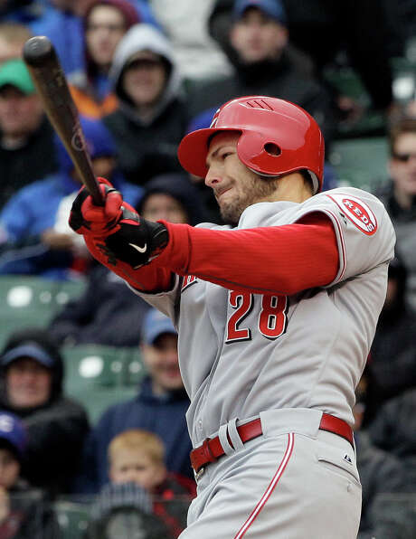 Chris Heisey smacks a two-run single against the Cubs during the first inning. Photo: AP