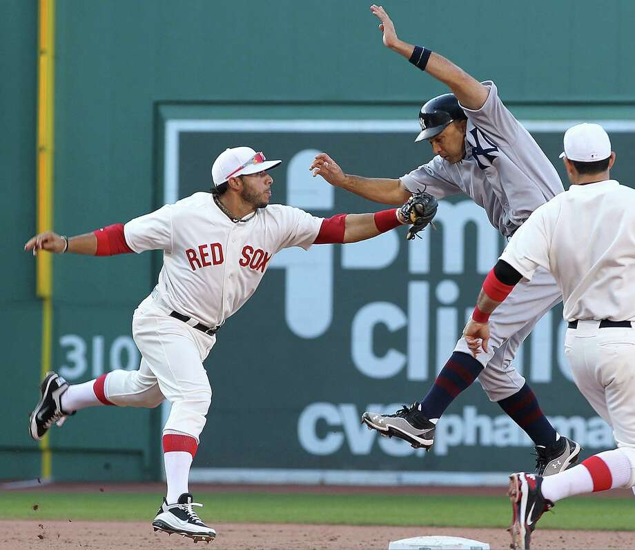 Boston's Mike Aviles puts the tag on the Yankees' Raul Ibanez during the game celebrating 100 years of Fenway Park in Boston. The Yankees prevailed 6-2. Photo: Jim Rogash / 2012 Getty Images